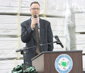 Woodgrain Millwork's Vice President Greg Easton speaks at a ribbon-cutting ceremony at the company's new manufacturing facility in Lenoir. Photo: the Caldwell County Economic Development Commission