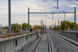 Rail line under construction at 61st Avenue and the Peña Blvd. station near DIA. The station will act as the rail hub for planned mixed-use development coming to the area. Photo: Denver International Airport