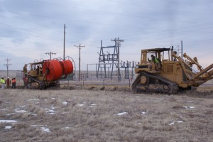 Installation of the 2 lit and 22 dark fibers in the project, as well as the installation of an empty fiber conduit spanning to Level 3, CenturyLink, AT&T and Sprint's transcontinental fiber facilities.  Photo: Niobrara Energy Development