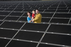 The Suneson family posing at SMUD's first Solar Shares program 1 MW solar array, Nilsen turkey farm in Wilton, California. Photo: Source: SMUD's photo library, Gordon Lazeroni, photographer