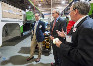 Motor Coach Industries plant manager Ron Storey (right) talks with Rep. Kevin Cramer (center) commerce department Commissioner Al Anderson (left) in Pembina during a recent event. Photo: North Dakota Department of Commerce