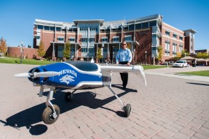 Kyle Pruett, a UNR graduate, is pictured with Drone America's Phoebus MK.III at the 4-H National Science Event day held at the university last October.  Photo courtesy: Nevada Advanced Autonomous Systems Innovation Center
