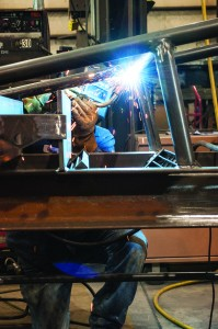 A welder manufactures product at L&H Industrial in Gillette, Wyoming. Locally owned L&H services mining, oil and gas, railroad and custom solutions clients with its six worldwide locations. Photo: Wyoming Business Council