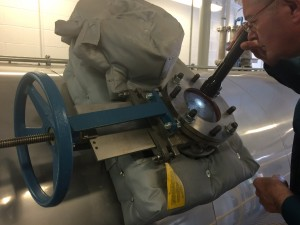 Viewing the slow-turn cake-drying process through the view port in the drum dryer. Photo: Jennifer Langford