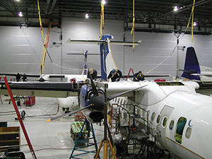 Empire Aerospace performing upper wing Repair. Courtesy of Empire Airlines