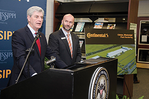 Mississippi Gov. Phil Bryant and Vice President of Commercial Vehicle Tires Continental Tire the Americas Paul Williams, celebrate Continental's decision facility in Hinds County, Miss., which will create 2,500 new jobs. Courtesy of the Mississippi Development Authority